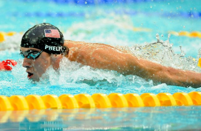 USA's Michael Phelps powers through the water in the Butterfly portion of the Men's 200 meter Individual Medley at the National Aquatics Center at the Summer Olympics in Beijing on August 15, 2008. Phelps won his sixth gold medal of the games in a World Record time of 1:54.23 (UPI Photo/Pat Benic)