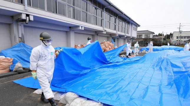 Member of Japan's Ground Self Defense Force decontaminate at the city office of Namie Machi, 8 kilometers from the Fukushima Dai-ichi nuclear power plant in Fukushima prefecture, Japan, on December 8, 2011. UPI/Keizo Mori