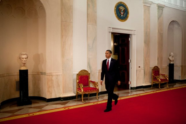 US President Barack Obama walks through the Cross Hall of the White House to make a televised statement May 1, 2011 in Washington, DC. President Obama announced that Osama bin Laden has been killed.