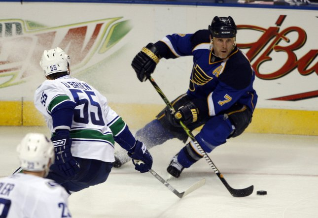 St. Louis Blues Kieth Tkachuk (7) stops to pass by Vancouver Canucks Shane O'Brien in the third period at the Scottrade Center in St. Louis on April 19, 2009. Vancouver won the game 3-2. (UPI Photo/Bill Greenblatt)