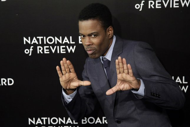 Chris Rock arrives on the red carpet at the 2014 National Board of Review Gala at Cipriani 42nd Street in New York City on January 6, 2015. Photo by John Angelillo/UPI