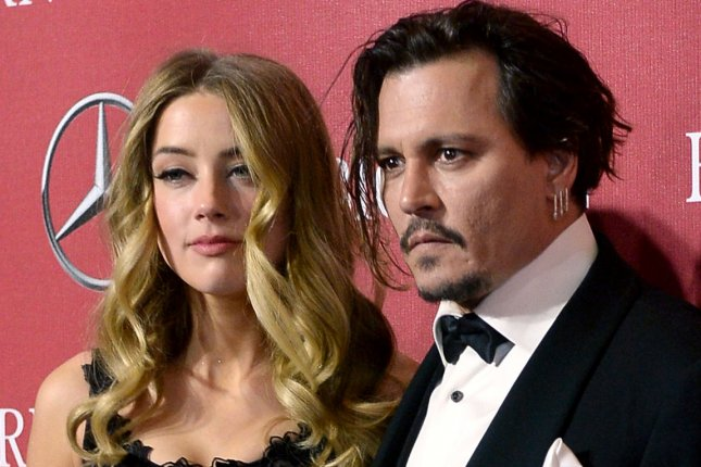Actors Amber Heard and Johnny Depp attend the 27th annual Palm Springs International Film Festival awards gala at the Palm Springs Convention Center in Palm Springs, California on January 2, 2016. File Photo by Jim Ruymen/UPI