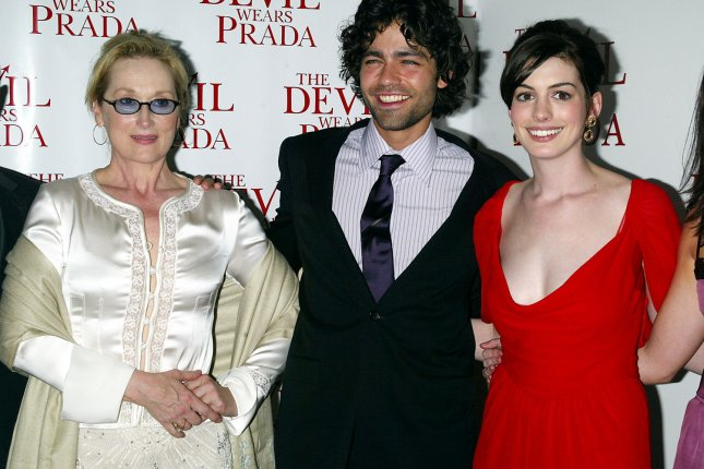 Meryl Streep, Adrian Grenier and Anne Hathaway arrive for the premiere of The Devil Wears Prada in New York on June 19, 2006. File Photo by Laura Cavanaugh/UPI