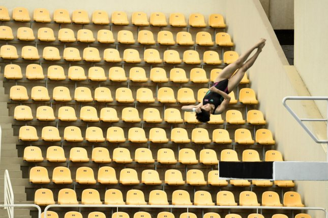 A platform diver makes a practice dive before empty seats at the venue for diving and water polo at the Olympic Park, as final preparations are made for the Olympics in Rio de Janeiro, Brazil, August 3, 2016. Opening ceremonies are in two days. Photo by Mike Theiler/UPI