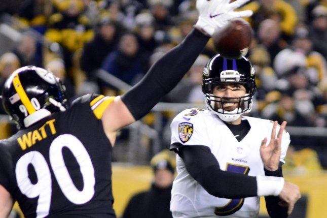 Baltimore Ravens quarterback Joe Flacco (5) throws past the hand of Pittsburgh Steelers outside linebacker T.J. Watt (90) in the first quarter at Heinz Field in Pittsburgh on December 10, 2017. Photo by Archie Carpenter/UPI