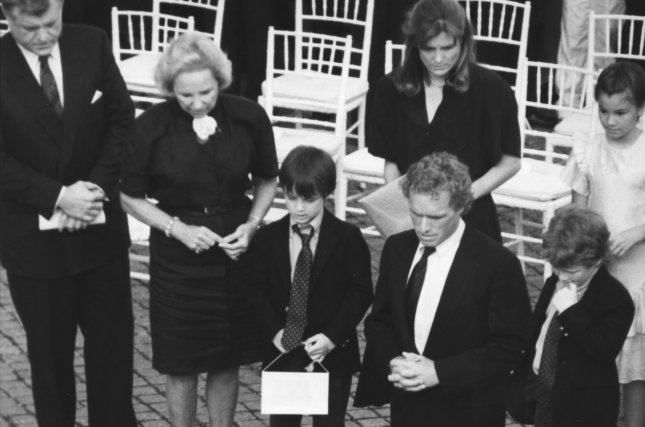 Sen. Edward Kennedy (far L), Ethel Kennedy (L), widow of Robert Kennedy, Rep. Joe Kennedy and other family members pay their respects at the grave of Robert F. Kennedy on June 6, 1988. UPI File Photo