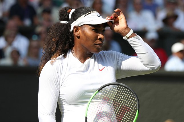 American Serena Williams readies herself in her match against France's Kristina Mladenovic on the fifth day of the 2018 Wimbledon championships on Friday in London. Photo by Hugo Philpott/UPI