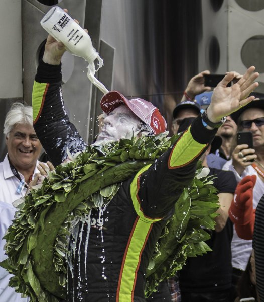 Simon Pagenaud douses himself with the traditional bottle of milk after winning the 103rd running of the Indianapolis 500 at the Indianapolis Motor Speedway in Indianapolis, Indiana. Photo by Edwin Locke/UPI