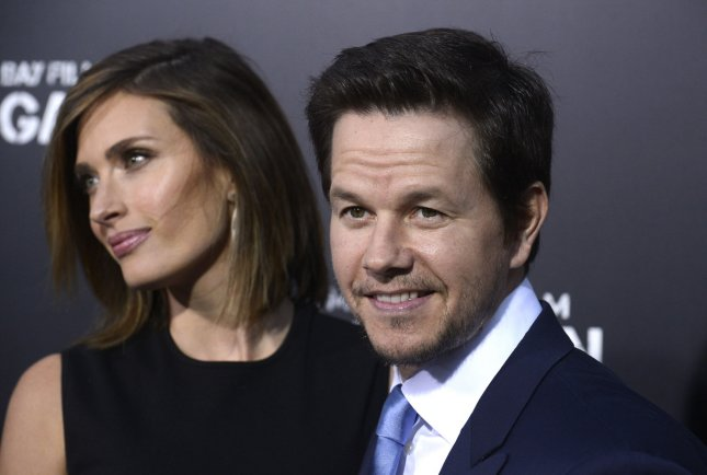 Cast member Mark Wahlberg and wife Rhea Durham (L) attend the premiere of the film Pain & Gain at the TCL Chinese Theatre in the Hollywood section of Los Angeles on April 22, 2013. UPI/Phil McCarten