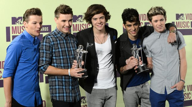 British boy band One Direction hold their awards for Most Share-Worthy Video and Best Pop Video, backstage at the MTV Video Music Awards at Staples Center in Los Angeles on September 6, 2012. UPI/Jim Ruymen