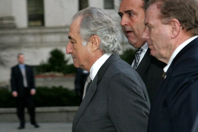 Bernard Madoff arrives at Federal Court where he is expected to plead guilty to securities fraud charges on March 12, 2009, in New York. Victims will also be in court to testify against the disgraced financier who is accused of masterminding a $50 billion Ponzi scheme. Photo by Monika Graff/UPI