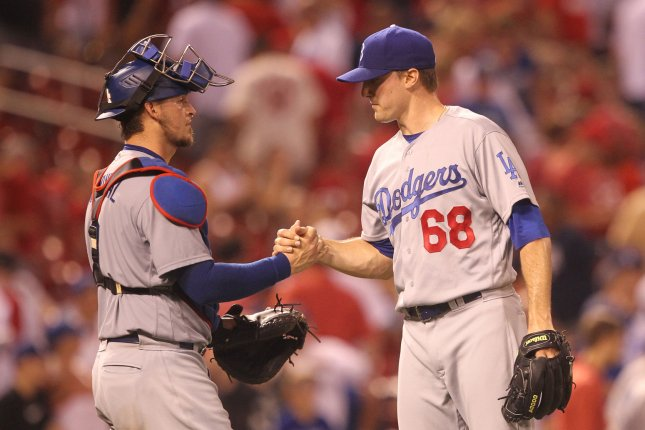 Los Angeles Dodgers pitcher Ross Stripling (68) and catcher Yasmani Grandal congratulate each other after a game against the St. Louis Cardinals on July 23, 2016 at Busch Stadium in St. Louis. File photo by Bill Greenblatt/UPI