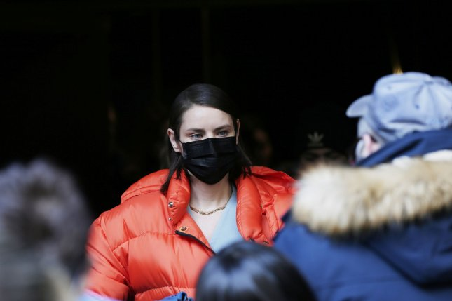 A woman wears a face mask outside after the Michael Kors FW20 Runway Show on February 12, 2020 in New York City. Photo by John Angelillo/UPI
