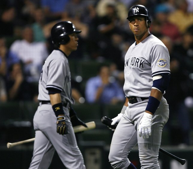 New York Yankees' Alex Rodriguez (R) walks off the field after striking out as Hideki Matsui of Japan walks up to bat during the ninth inning at U. S. Cellular Field in Chicago on July 30, 2009. The White Sox won 3-2. UPI/Brian Kersey