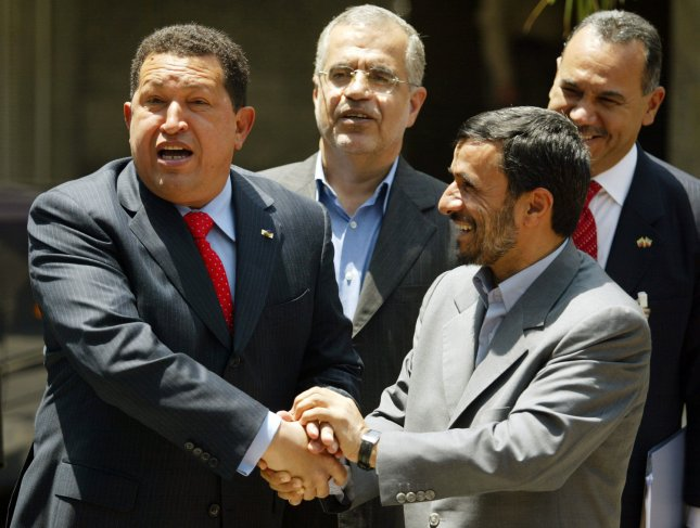 Iran's President Mahmoud Ahmadinejad (R) shakes hands with Venezuela's President Hugo Chavez (L) during a welcoming ceremony for Chavez in Tehran, Iran on July 1, 2007. Chavez arrived in Tehran late Saturday for a two-day visit which officials said was aimed at boosting political and economic cooperation between the two countries. (UPI Photo/Mohammad Kheirkhah)