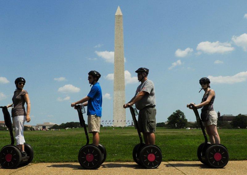A Segway tour pauses near the Washington Monument in Washington Aug. 7, 2010. File/UPI/Alexis C. Glenn