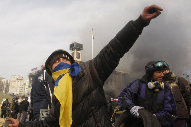 Anti-government protesters clash with the Ukrainian riot police at a barricade on February 19, 2014. At least 25 people have been killed in the worst violence since Ukraine gained its independence in 1991. UPI/Ivan Vakolenko