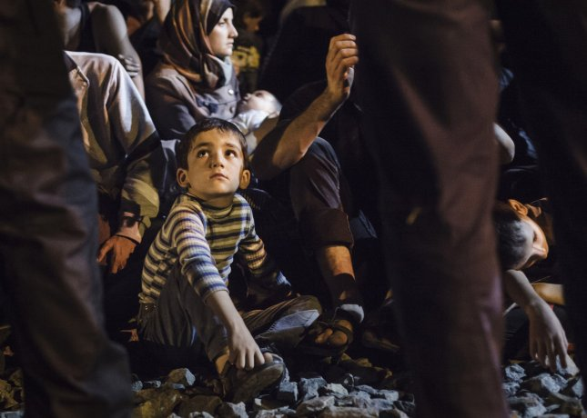 Refugees and migrants wait in the Tovarnik train station to board a train that will transport them to Austria on September 18, 2015 in Tovarnik, Croatia. File Photo by Achilleas Savallis/UPI