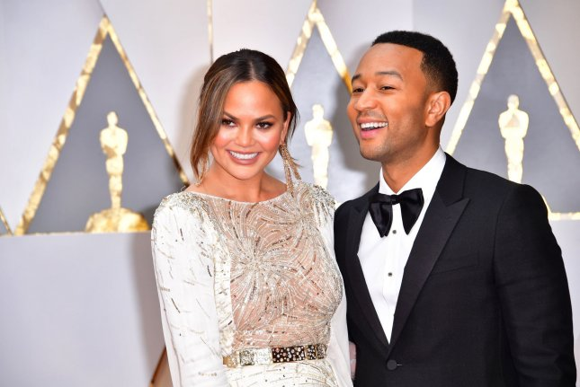 Chrissy Teigen (L) and John Legend attend the Academy Awards on Sunday. Teigen appeared to fall asleep on her husband's shoulder during Casey Affleck's acceptance speech for Best Actor. Photo by Kevin Dietsch/UPI
