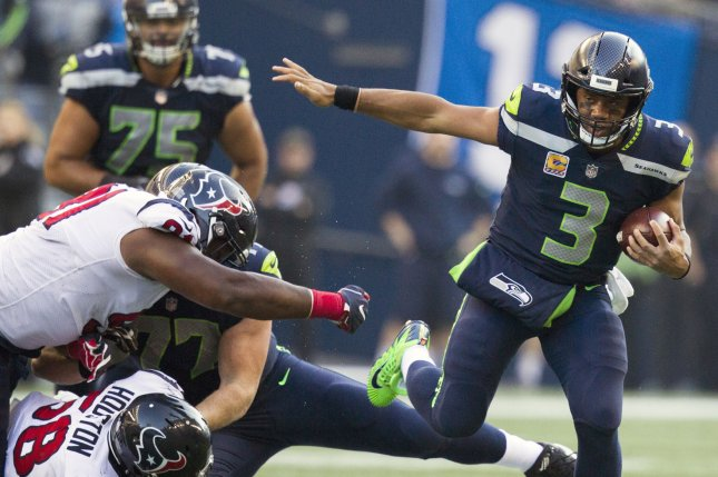 Seattle Seahawks quarterback Russell Wilson (3) scrambles for 11-yard gain against the Houston Texans in the fourth quarter at CenturyLink Field in Seattle, Washington on October 29, 2017. File photo by Jim Bryant/UPI