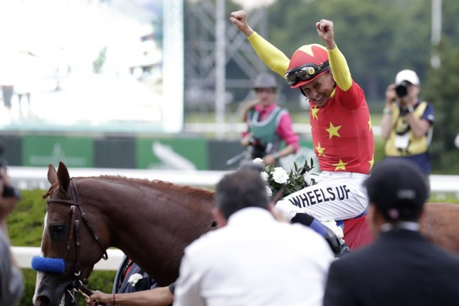 Jockey Mike Smith aboard Justify celebrates after winning the Triple Crown and the 150th Belmont Stakes on June 9, 2018 in Elmont, New York. Justify became the 13th Triple Crown winner in history and follows American Pharoah who pulled off the win in 2015 after a 35-year drought. Photo by Jason Szenes/UPI