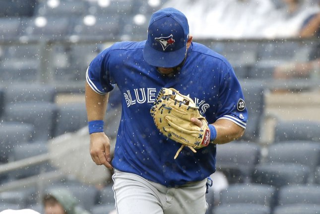 Toronto Blue Jays designated hitter Kendrys Morales jogs to the dugout in the rain after the fifth inning against the New York Yankees on August 19, 2018 at Yankee Stadium in New York City. Photo by John Angelillo/UPI