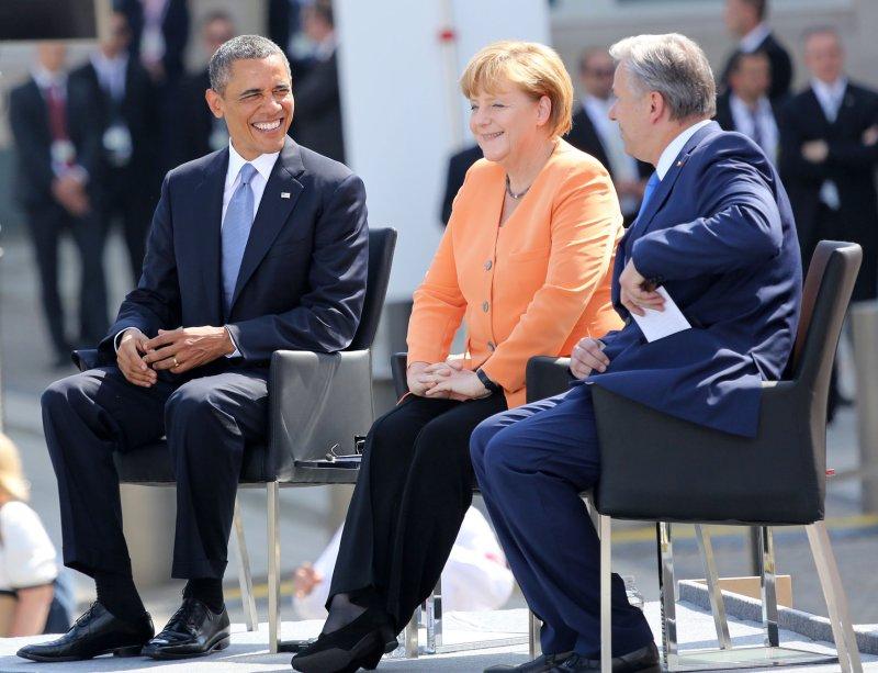 U.S. President Barack Obama (L), German Chancellor Angela Merkel (C) and Berlin Mayor Klaus Wowereit arrive at the Brandenburg Gate in Berlin on June 19, 2013. UPI/David Silpa
