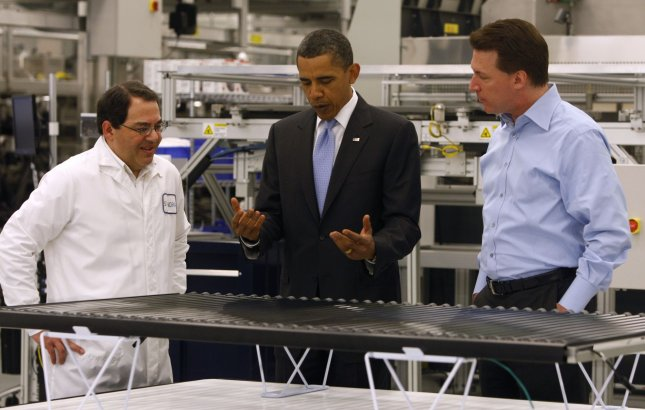 U.S. President Barack Obama tours the Solyndra solar panel company with Solyndra executive vice president Ben Bierman (L) and Comapny CEO Chris Gronet (R) in Fremont, California on May 26, 2010. UPI/Paul Chinn/Pool