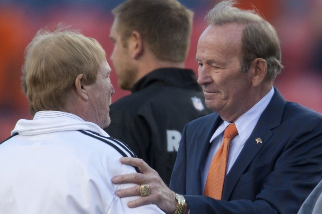 Denver Broncos owner Pat Bowlen (R) greets Oakland Raiders owner Mark Davis at midfield at Sports Authority Field at Mile High in Denver on September 23, 2013. Denver hosts AFC divisional rival Oakland for Monday Night Football. (File/UPI/Gary C. Caskey)