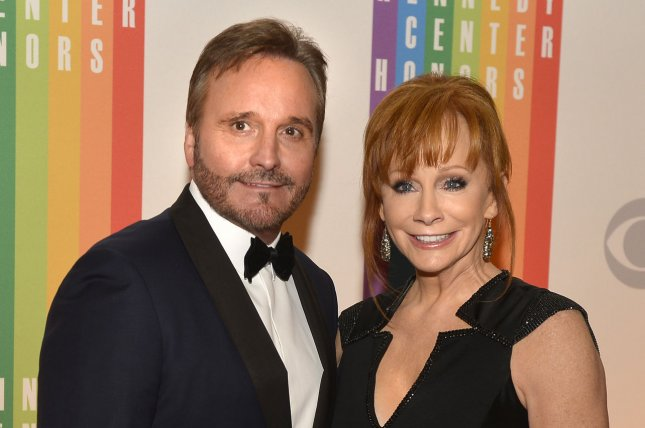 Reba McEntire (R) and Narvel Blackstock at the Kennedy Center Honors ceremony on December 7, 2014. File photo by Mike Theiler/UPI