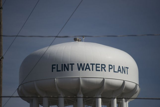 A water plant tower is seen in Flint, Mich., on March 11, following the discovery of lead contamination in the city. Wednesday, the EPA released a report that details possible changes to a federal law limiting the amount of lead and copper in drinking water. File Photo by Molly Riley/UPI