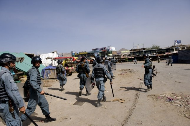 Afghan police patrol the streets in Kabul on September 15, 2010. On Thursday, a suicide bomber targeted the 9th district police, killing at least 11 people. UPI File Photo