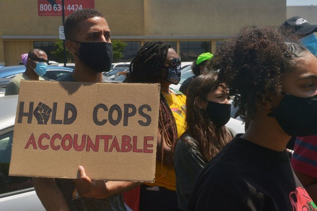 Activists protest social inequality and lack of police accountability at a rally Friday in Los Angeles.Thousands nationwide celebrated the date, Juneteenth, which marks the end of slavery in the United States. Photo by Jim Ruymen/UPI