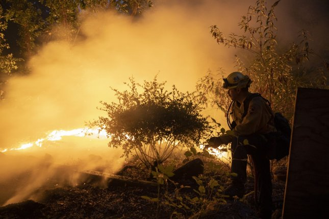 The blazes have killed seven people and destroyed more than 1,400 structures.Photo by Peter DaSilva/UPI