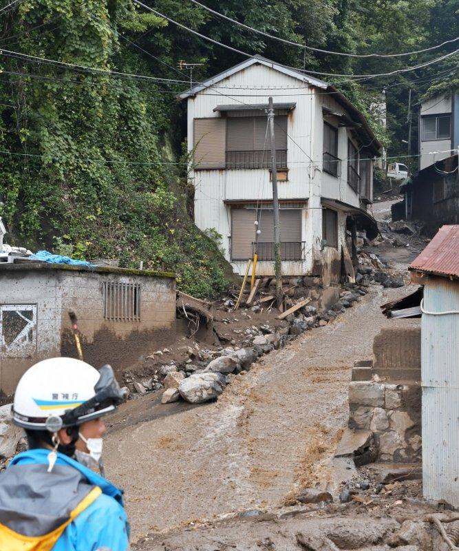 Crews sift through debris of Japan mudslide; at least 4 dead and 24 missing