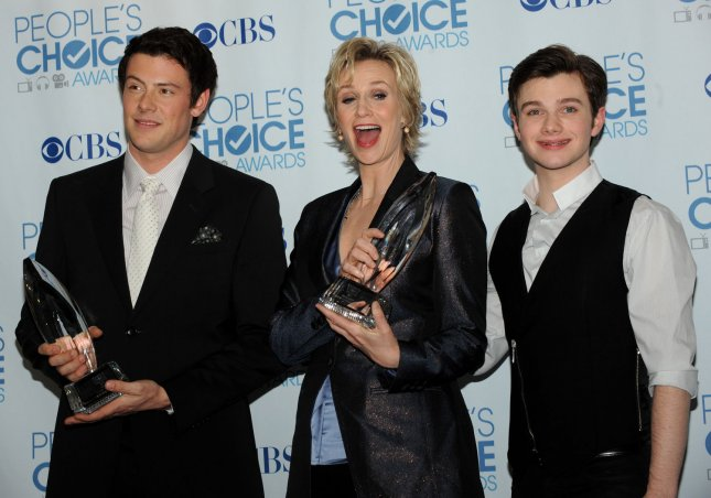 Jane Lynch (C), winner of the favorite comedy series actress award for Glee, poses backstage with Cory Monteith (L) and Chris Colfer, who accepted the favorite comedy series award for the same show, at the People's Choice Awards in Los Angeles on January 5, 2011.UPI/Jim Ruymen