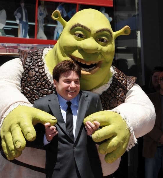 Shrek is joined by actor Mike Myers as the character receives a star on the Hollywood Walk of Fame in Los Angeles on May 20, 2010. Myers provides the voice of Shrek in the animated film franchise. UPI/Jim Ruymen