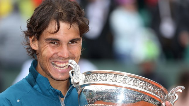 Spaniard Rafael Nadal bites the championship trophy after winning his French Open men's final match against fellow Spaniard David Ferrer at Roland Garros in Paris on June 9, 2013. Nadal defeated Ferrer 6-3, 6-2, 6-3 to become the first player ever to win the same Grand Slam tournament eight times. UPI/David Silpa
