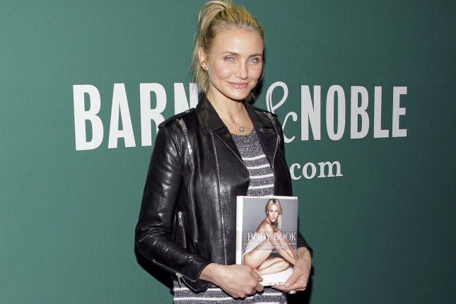 Cameron Diaz holds a copy of her new book The Body Book at Barnes & Noble Union Square in New York City on January 6, 2014. UPI/John Angelillo