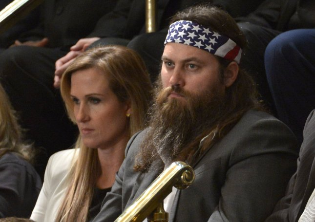 Willie Robertson of Duck Dynasty listens as U.S. President Barack Obama makes his State of the Union address to a joint session of congress and the American people in the House Chamber at the U.S. Capitol on January 28, 2014 in Washington, DC. UPI/Kevin Dietsch