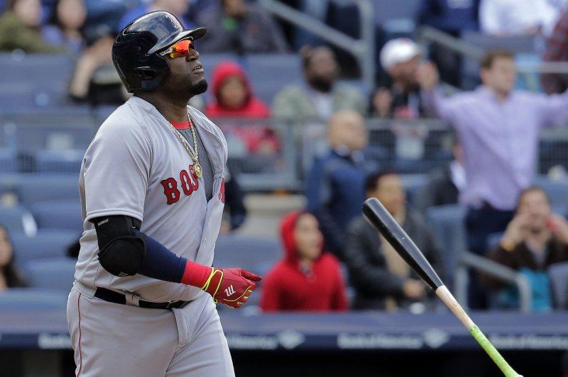 Boston Red Sox designated hitter David Ortiz tosses his bat. Photo by Ray Stubblebine/UPI