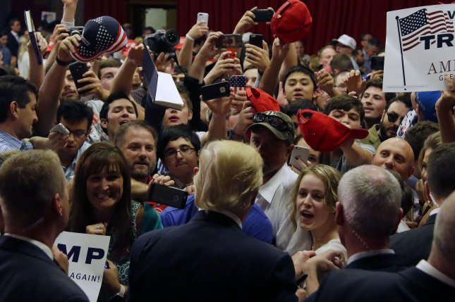 Republican candidate for President Donald Trump signs autographs as he exits after speaking at a fundraising event for New Jersey Governor Chris Christie at the Lawrenceville National Guard Armory on May 19, 2016, in Lawrence Township, NJ. On Friday, Trump made campaign appearances in Fresno and San Diego in California. Photo by John Angelillo/UPI