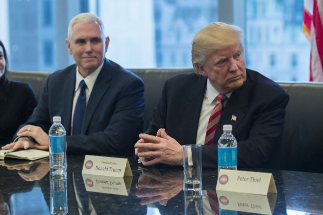 President-elect Donald Trump's transition team is said to be exploring ways to restructure and pare back the U.S. intelligence community, of which Trump, pictured at right, has been increasingly harshly critical of since his Nov. 8 victory in the presidential election. Pool photo by Albin Lohr-Jones/UPI