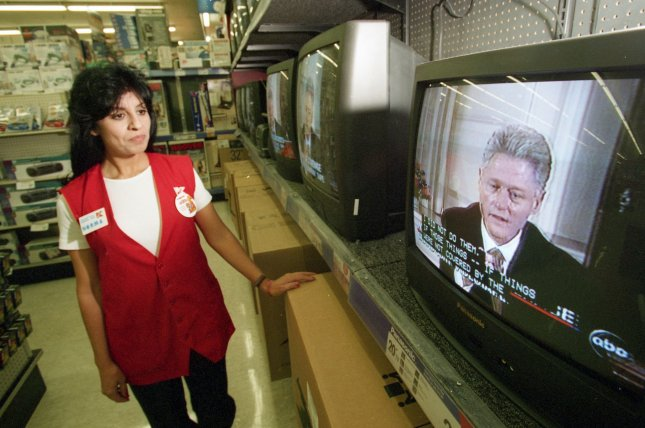 Norma Eggleston, a Kmart employee in El Paso, Texas, watches President Bill Clinton's videotaped deposition to the Independent Counsel Kenneth Starr on televisions in the store on September 21, 1998. File Photo by Jack Kurtz/UPI