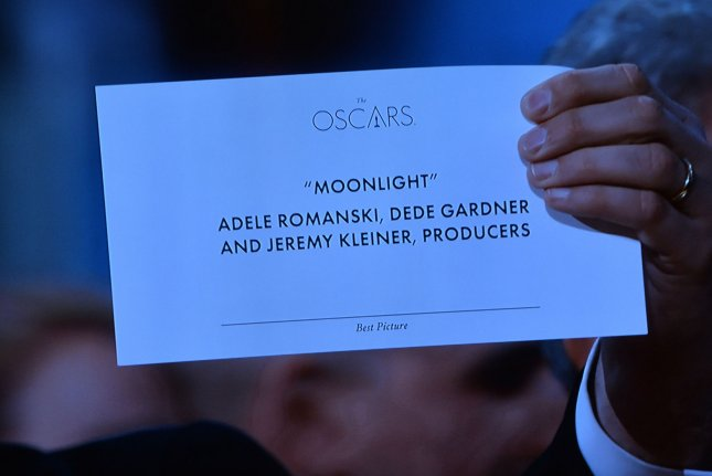 Fred Berger, producer of La La Land, holds up the best picture award for Moonlight to the TV camera after he had come up on stage to accept the award after the wrong picture was announced at the 89th annual Academy Awards in Los Angeles on Sunday night. The two PricewaterhouseCoopers accountants responsible forthe fiasco won't be handing out Oscar envelopes anymore, the Academy of Motion Picture Arts and Sciences confirmed Wednesday. Photo by Jim Ruymen/UPI