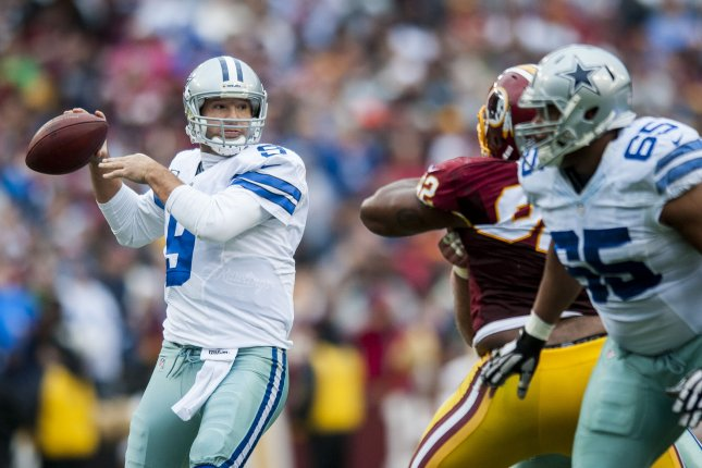 Former Dallas Cowboys quarterback Tony Romo looks for an open receiver during second quarter action against the Washington Redskins at FedEx Field in Landover, Maryland on December 28, 2014. File photo by Pete Marovich/UPI