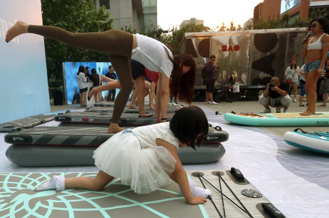 A new study shows kids can benefit from yoga. File Photo by Stephen Shaver/UPI