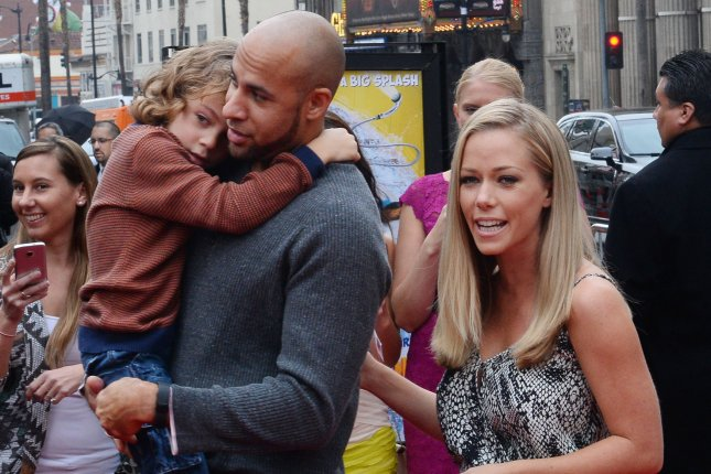 Kendra Wilkinson (R), pictured with Hank Baskett and son Hank, apologized Wednesday after live-tweeting an argument with Baskett. File Photo by Jim Ruymen/UPI