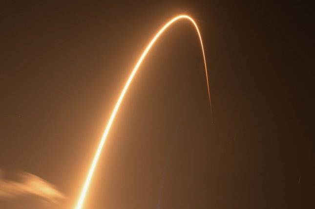 A time exposure captures the SpaceX Falcon 9 rocket as it launched the first 60 of the company's Starlink Satellites at 10:30 p.m. Thursday from Complex 40 at the Cape Canaveral Air Force Station, Fla. Photo by Joe Marino-Bill Cantrell/UPI