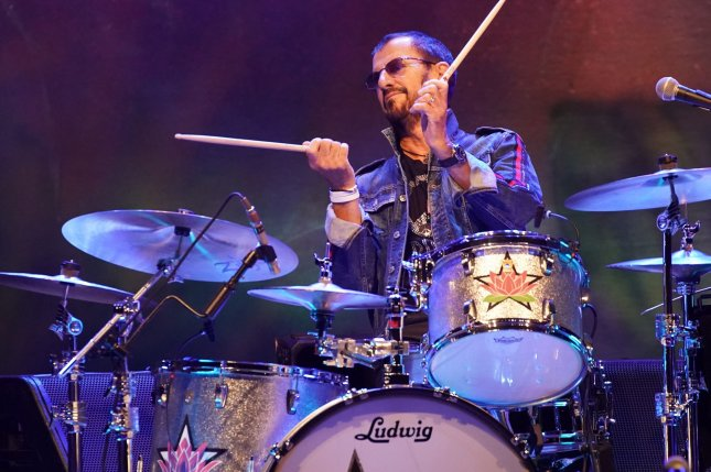 Ringo Starr & His All-Starr Band perform at the 50th anniversary of the Woodstock Music Festival at Bethel Woods Center For The Arts on Friday. Photo by John Angelillo/UPI